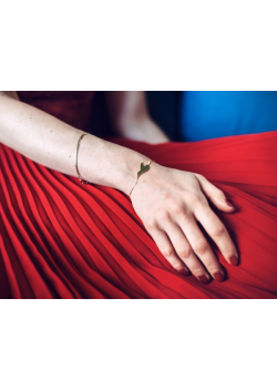 Caroline Baly is wearing our yellow gold silver L envol bracelet